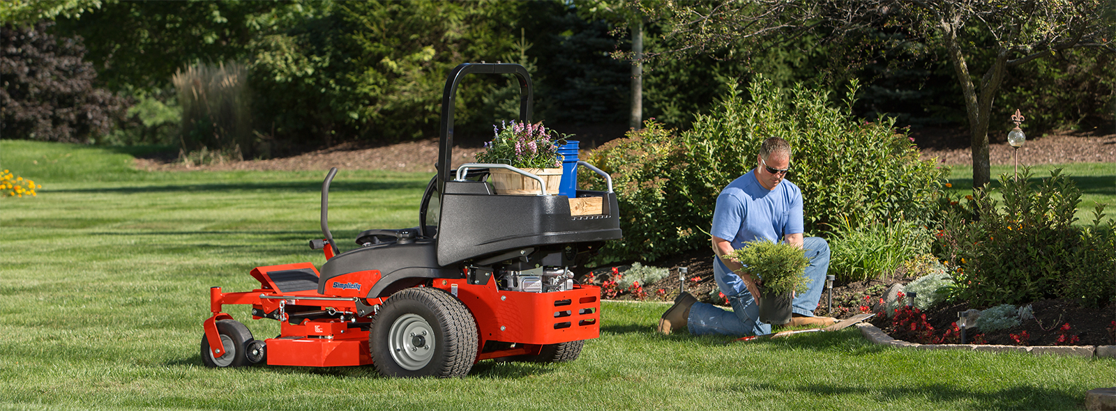 Man landscaping with Simplicity zero turn mower