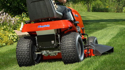 Simplicity lawn tractor cutting the grass while striping