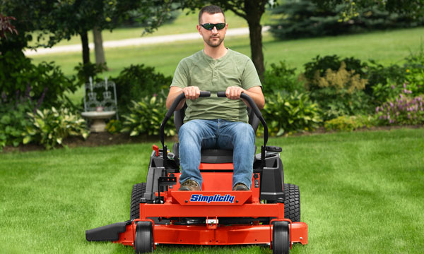 Man mowing the lawn with a Simplicity zero turn mower